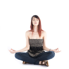 Young Woman Sitting in Yoga Pose with Eyes Closed