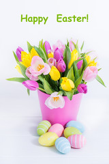 Easter tulips and colourful eggs