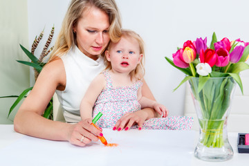 Mother and daughter drawing a picture