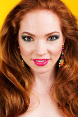 Beautiful redheaded girl with colorful earrings