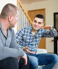 Buddies chatting in home interior