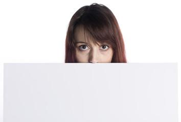 Young Woman Peeking Behind White Cardboard
