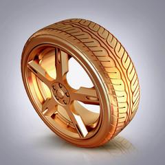 Golden tire on grey  background.