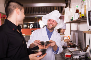 Chefs and waiter working
