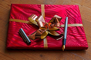 Gift package with open pen on it