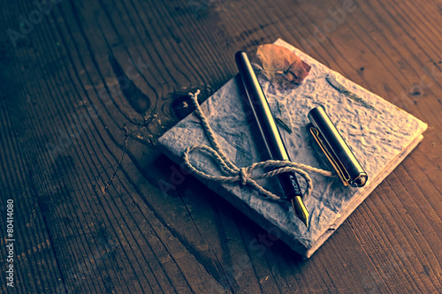 Tuinposter Retro Old diary memories with fountain pen on a wooden table 2