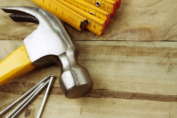 Hammer, nails and ruler closeup