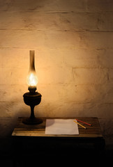 Kerosene lantern on wooden table