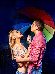 Couple  under  rain with umbrella .