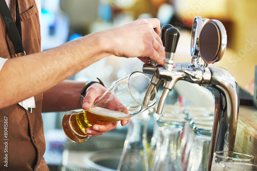 barman pouring beer - 80415867