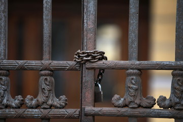 Iron gate scured with a chain and a padlock