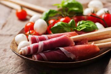 Italian prosciutto with tomato, mozzarella and basil