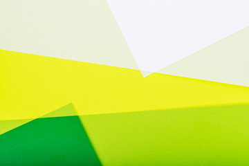 Abstract color paper background in green tones.