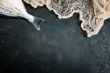 Fresh Fish with fishing net