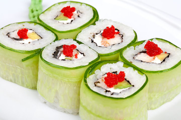 Sushi roll with avocado, cucumber and caviar.