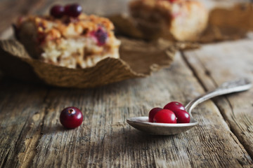 fresh cranberries and a cake