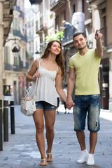 Couple walking through city