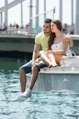 Couple taking sunbath on the pier