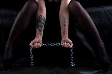 Photo of sitting woman with chains