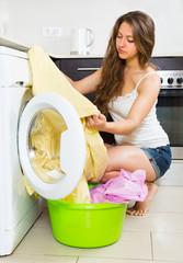 Girl near washing machine