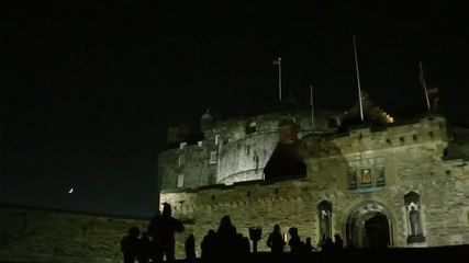 Silhouettes walking night Edinburgh Castle - Scotland