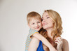 Portrait of happy mother hugging her son