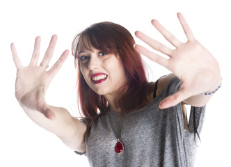 Scared woman making stop gesture sign on hands