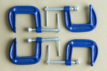 Four blue steel g-clamps