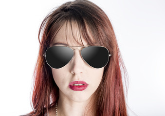 Close Up of Young Woman Wearing Sunglasses