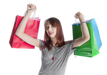 Young Woman Holding Colorful Shopping Bags