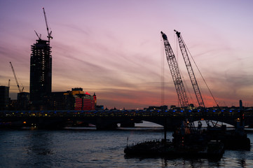 London skyline view from millennium bridge at sunset