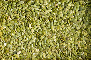 Background texture of green hulled pumpkin seeds