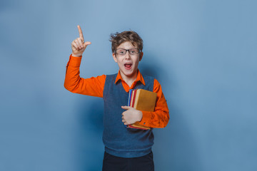 European-looking  boy of ten years in glasses thumbs up, the