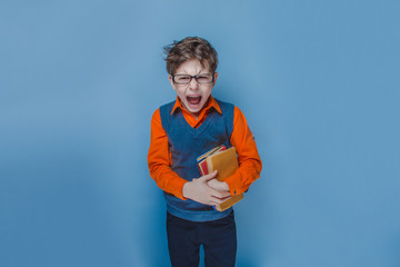 European-looking  boy of ten years in glasses opened his mouth