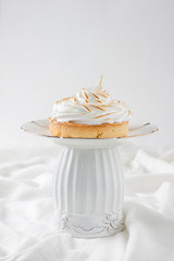 cupcakes with meringue on a white background