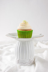 cupcakes with cream on a white background