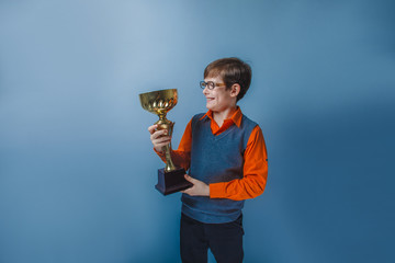 European-looking boy of ten years in glasses holding a cup award