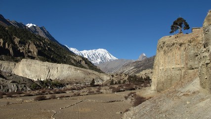 Scene in Manang, fields in high altidude surroundet by mountains