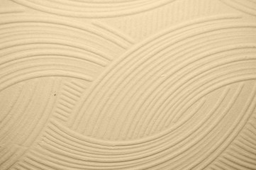 beige wall with plaster relief