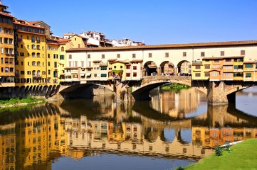 Landmark Ponte Vecchio with reflections, Florence, Italy