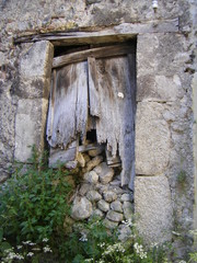 Broken wooden door in Italian village
