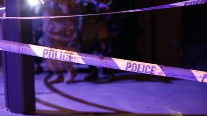 soldiers rip down crime scene tape in dark