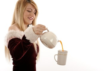 Girl with a cup of tea. Levitation, kettle hangs in the air