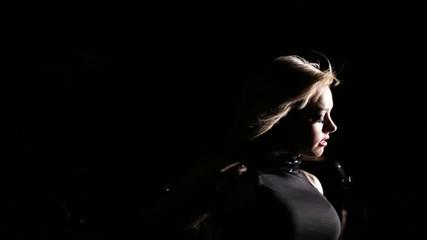 sexy woman dancing in wind in dark