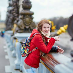 Young tourist in Paris, on the Pont Alexandre III