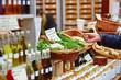 Leinwanddruck Bild - Man buying fresh leek on market