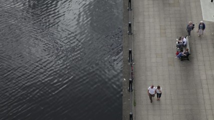 tourists on riverbank birdseye perspective drone