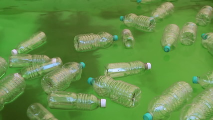 Plastic Bottles Floating On Polluted Water