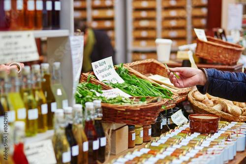 Man buying fresh leek on market - 80429811