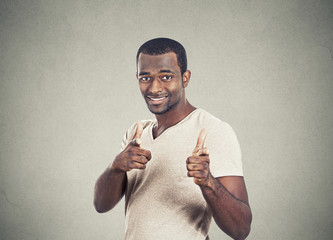 Happy man with two hands guns sign gesture pointing at you